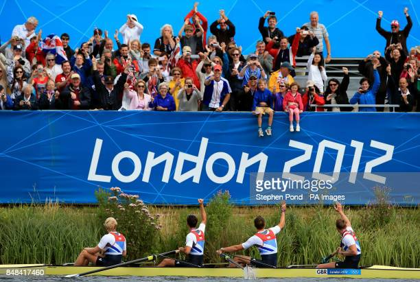 Great Britain's Men's Four of Andrew Triggs Hodge Tom James Pete Reed and Alex Gregory are cheered by the crowd as they celebrate winning gold in the...