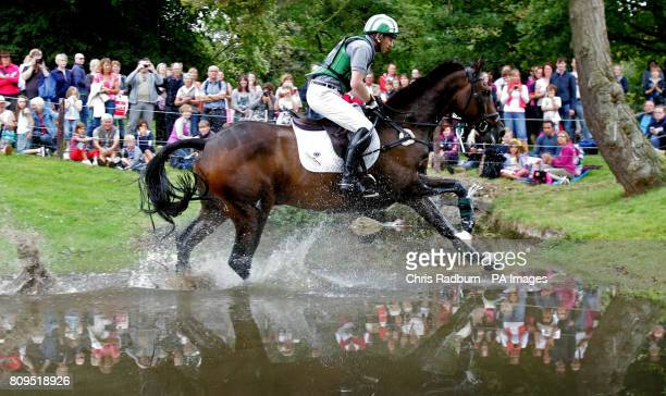 Great Britain's Michael Owen on board The Highland Prince as they pass through the Trout Hatchery during The Land Rover Burghley Horse Trials Stamford