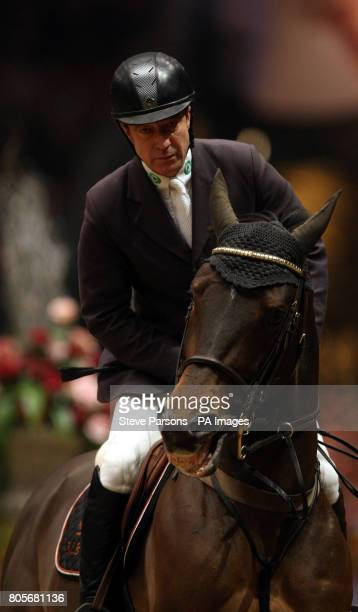 Great Britain's Michael Whitaker rides GIG Tackeray in the Martin Collins Eraser Stakes during the London International Horse Show at the Olympia...