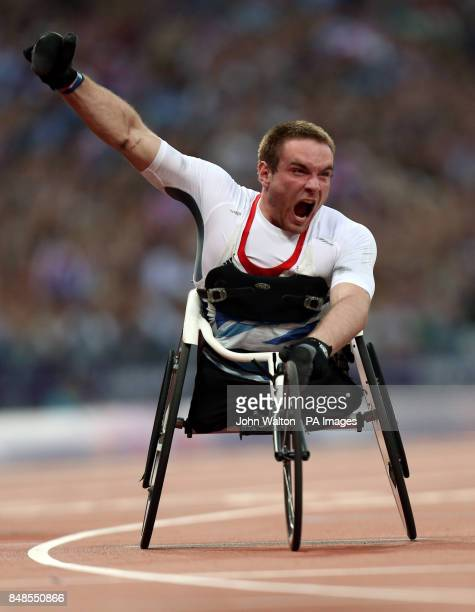 Great Britain's Mickey Bushell celebrates winning Gold during the Men's 100m T53 at the Olympic Stadium London
