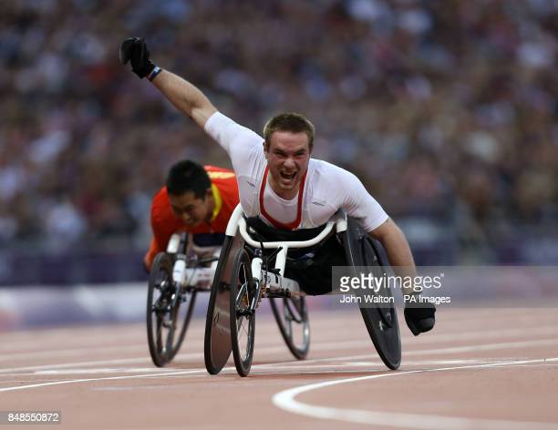 Great Britain's Mickey Bushell celebrates winning Gold during the Mens 100m T53 at the Olympic Stadium London