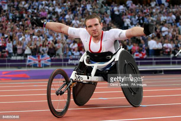 Great Britain's Mickey Bushell celebrates winning gold in the mens 100m T53 category in the Olympic Stadium