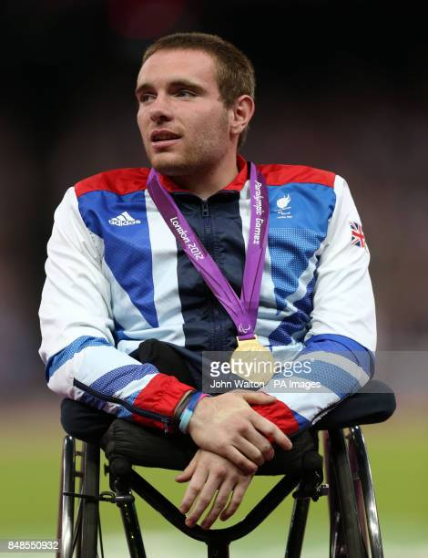 Great Britain's Mickey Bushell celebrates winning Gold in the Mens 100m T53 at the Olympic Stadium London