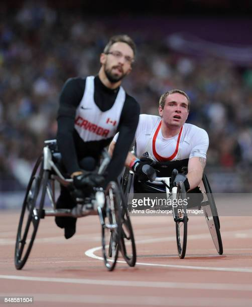 Great Britain's Mickey Bushell reacts after he crosses the line to finish fourth in the Men's 200m T53 Final at the Olympic Stadium during the...