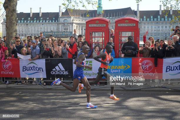 Great Britain's Mo Farah and Kenya's Emmanuel Mutai in the final mile on Embankment during the Virgin Money London Marathon London