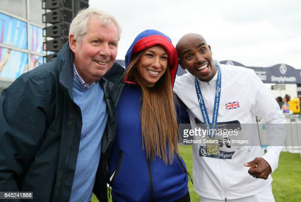 Great Britain's Mo Farah celebrates winning the men's elite race with wife Tania and commentator Brendan Foster during the Great North Run in...