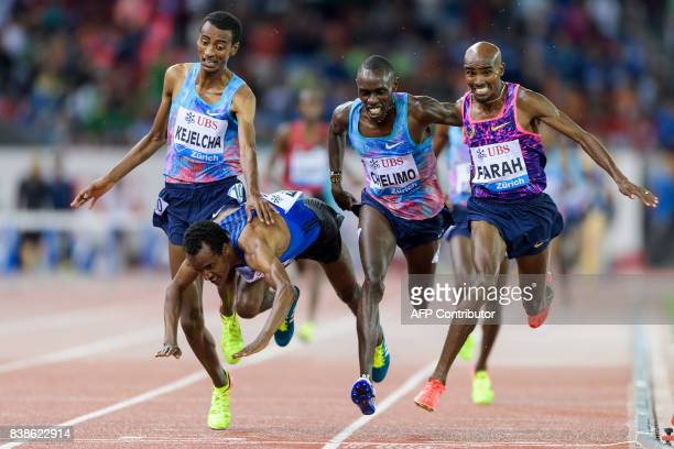 Great Britain's Mo Farah crosses the finish line and wins ahead of secondplaced US Paul Chelimo thirdplaced Ethiopia's Muktar Edris and fourthplaced...