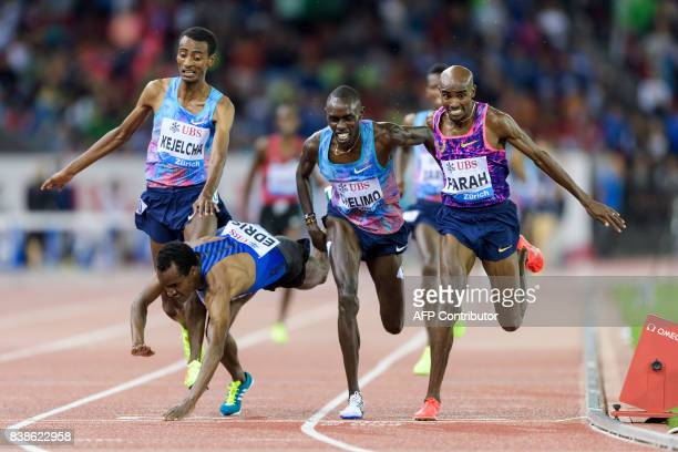 TOPSHOT Great Britain's Mo Farah crosses the finish line and wins ahead of secondplaced US Paul Chelimo thirdplaced Ethiopia's Muktar Edris and...