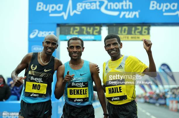 Great Britain's Mo Farah Ethiopa's Kenenisa Bekele and Ethiopia's Haile Gebrselassie after the 2013 Great North Run between Newcastle and South...