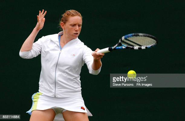 Great Britain's Naomi Cavaday in action against Switzerland's Martina Hingis during The All England Lawn Tennis Championship at Wimbledon