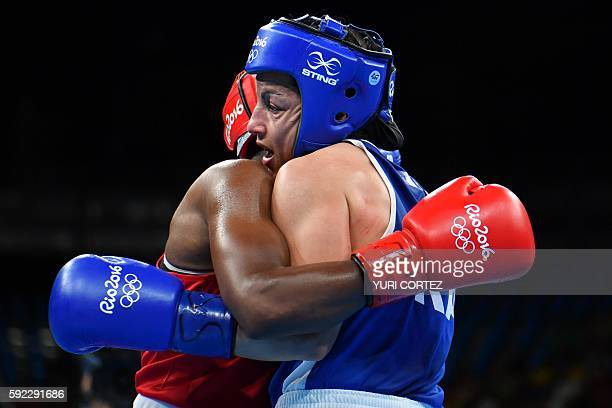Great Britain's Nicola Adams fights France's Sarah Ourahmoune during the Women's Fly Final Bout at the Rio 2016 Olympic Games at the Riocentro...