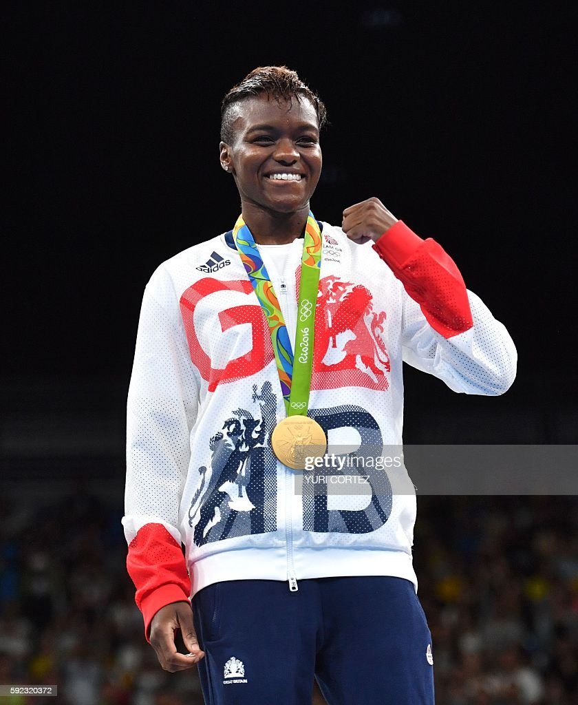 Great Britain's Nicola Adams poses on the podium with a gold medal during the Rio 2016 Olympic Games at the Riocentro Pavilion 6 in Rio de Janeiro on...