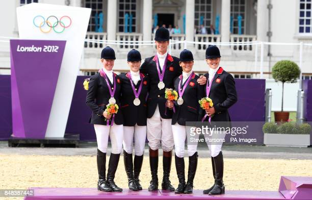 Great Britain's Nicola Wilson Zara Phillips William FoxPitt Mary King and Kristina Cook with their silver medalsl during the Team Eventing Medal...