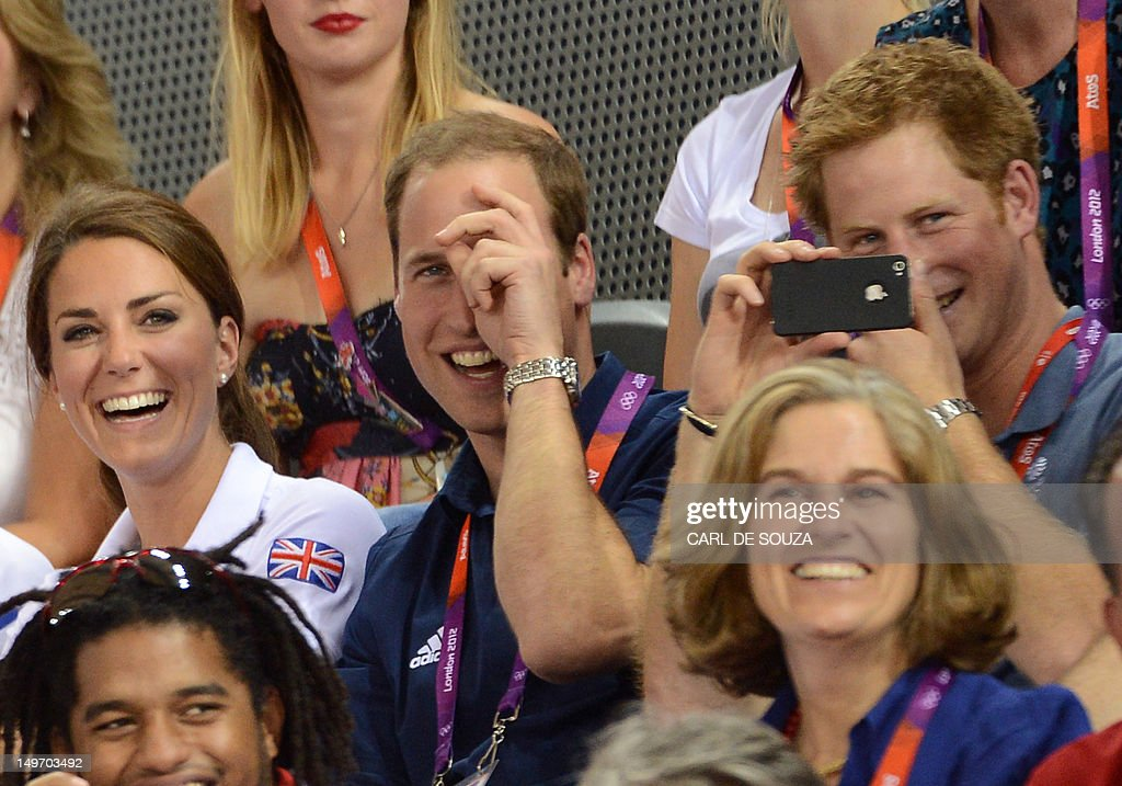 Great Britain's Prince Williams (C), his wife Kate Middleton and Prince Harry attend the Men's team sprint track cycling event of London 2012 Olympic games, on August 2, 2012 in London.