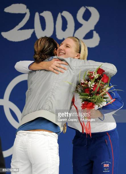 Great Britain's Rebecca Adlington celebrates winning gold in the women's 800 metres freestyle final with sliver medalist Alessia Filippi in a...