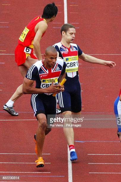 Great Britain's Richard Strachan passes the baton to Graham Hedman in the men's 4x400m relay during the Norwich Union International at the Alexander...