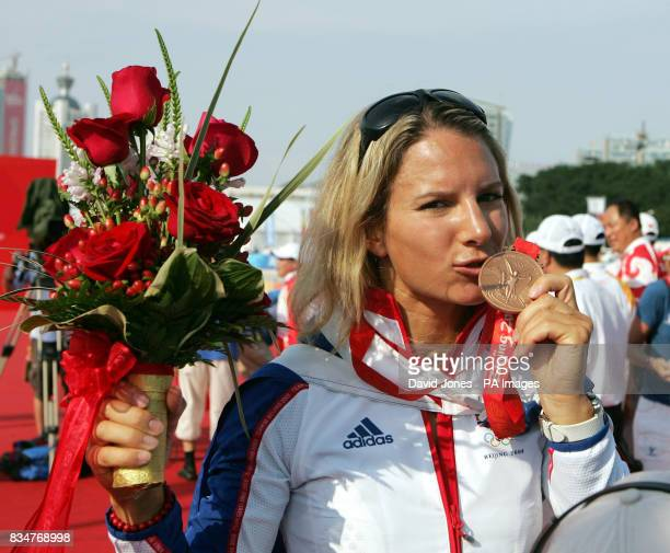 Great Britain's RSX sailor Bryony Shaw celebrates after receiving her bronze medal after the final round of her RSX Sailing Competition at the 2008...