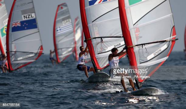 Great Britain's RSX sailor Bryony Shaw chases Italy's Alessandra Sesini at the 2008 Beijing Olympic Games' Sailing Centre in Qingdao China