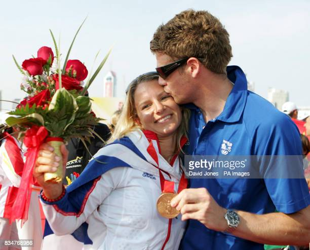 Great Britain's RSX sailor Bryony Shaw is kissed by boyfriend Greg King after receiving her bronze medal after the final round of her RSX Sailing...