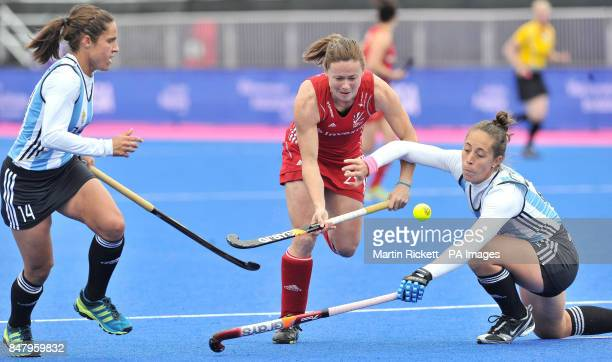 Great Britain's Sarah Thomas battles with Argentina's Silvina D'Elia and Mercedes Margalot during the Gold Medal Hockey match during the Visa...