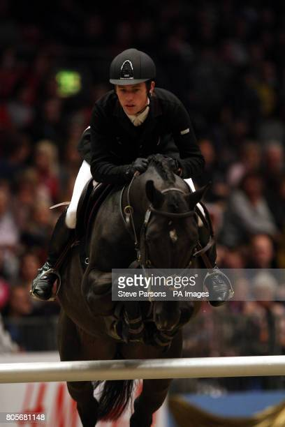 Great Britain's Scott Brash rides Sebastian III in the Martin Collins Eraser Stakes during the London International Horse Show at the Olympia...