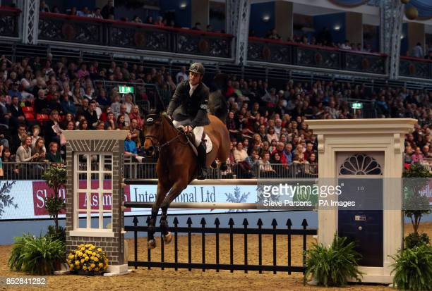 Great Britain's Scott Brash riding Hello Annie competes in the Shelly Ashman International Ltd E M Rogers Ltd Snowman stakes during day four of The...