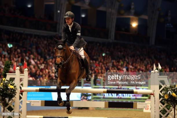 Great Britain's Scott Brash riding Hello Annie in the Santa Stakes during day three of The London International Horse Show at the Olympia Exhibition...