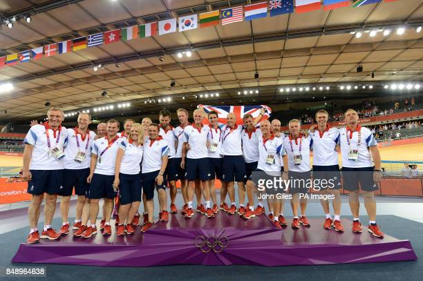 Great Britain's Shane Sutton and David Brailsford with the Union Flag celebrates with the British cycling coaches after their gold medal haul on day...