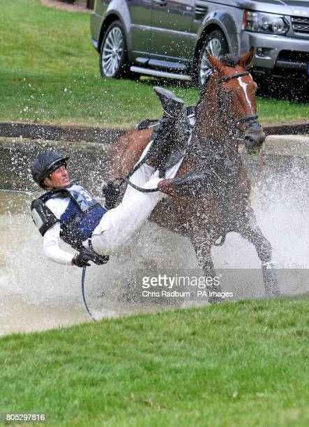 Great Britain's Simon Lawrence and Watch It Fall at the Trout Hatchery as they compete in the Cross Country during day three of the Burghley Horse...