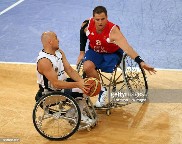 Great Britain's Simon Munn and Germany's Lars Lehmann battle for the ball during the Men's Wheelchair Basketball QuarterFinals