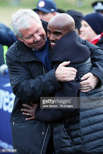 Great Britain's Sir Mo Farah gets a hug from Brendan Foster after finishing seventh in the Men's 8km Event during the 2017 Great Edinburgh...