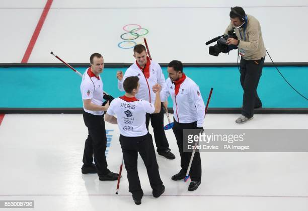 Great Britain's skip David Murdoch celebrates with team mates after defeating Russia in the Curling Round Robin at the Ice Cube Curling Centre during...