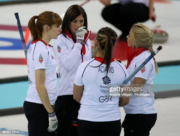 Great Britain's Skip Eve Muirhead speaks with her team mates Claire Hamilton Vicky Adams and Anna Sloan during their Curling Round Robin match at the...