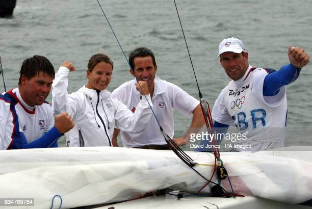 Great Britain's Star crew Iain Percy and Andrew Simpson are joined by Gold Medal winners Bryony Shaw and Ben Ainslie on their way to port after the...