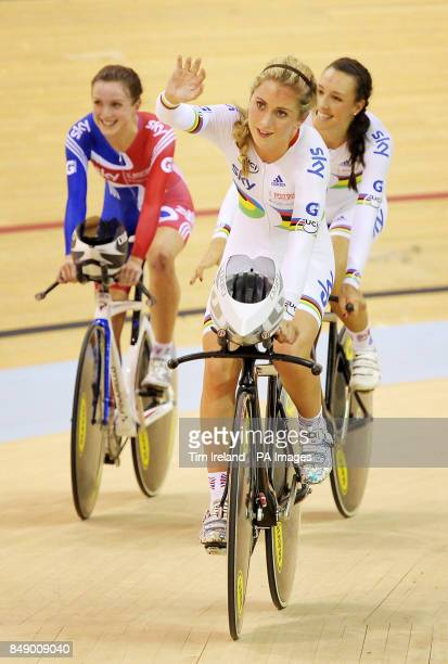 Great Britain's team pursuit squad of Laura Trott Dani King and Elinor Barker celebrate gold during day one of the UCI Track Cycling World Cup at the...