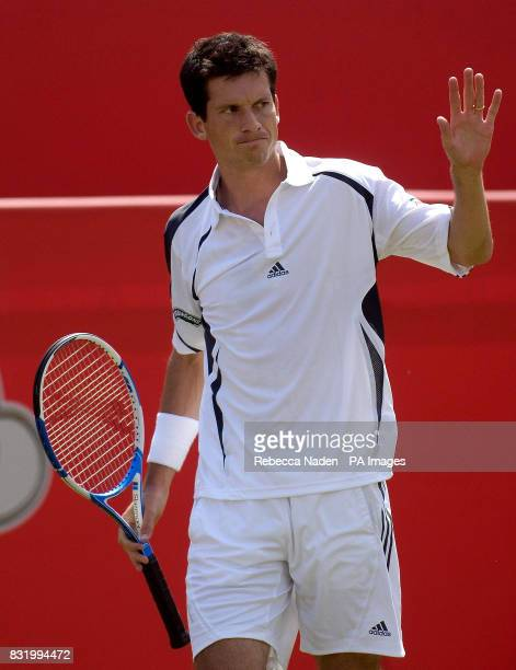 Great Britain's Tim Henman acknowledges a net cord during the first round match against USA's Andre Agassi in The Stella Artois Championships at The...