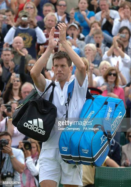 Great Britain's Tim Henman applauds the fans as he walks off following his defeat to Spain's Feliciano Lopez during The All England Lawn Tennis...