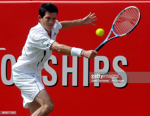 Great Britain's Tim Henman in action against Croatia's Marin Cilic during the Artois Championships at The Queen's Club London