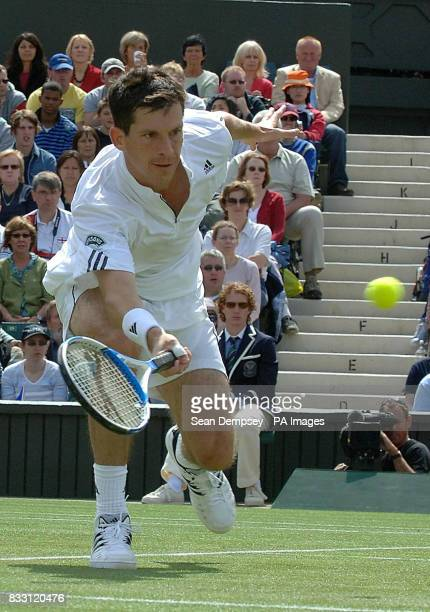 Great Britain's Tim Henman in action against Spain's Feliciano Lopez during The All England Lawn Tennis Championship at Wimbledon
