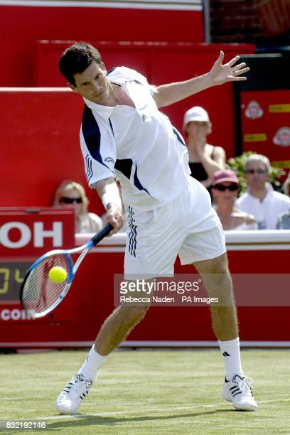Great Britain's Tim Henman in action during the first round match against USA's Andre Agassi in The Stella Artois Championships at The Queen's Club...