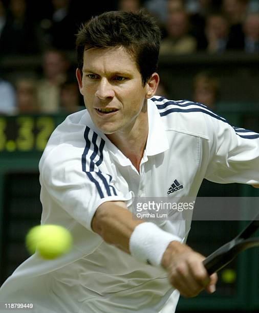 Great Britain's Tim Henman in play during his Quarterfinal match against Frenchman Sebastien Grosjean Image from July 2 2003 before rain delayed play