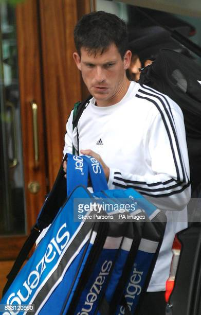 Great Britain's Tim Henman leaves from Wimbledon after losing his second round match against Spain's Feliciano Lopez during The All England Lawn...