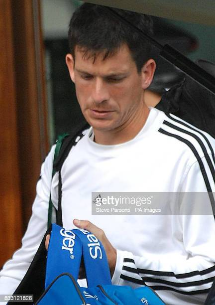 Great Britain's Tim Henman leaves from Wimbledon after losing his second round match against Spain's Feliciano Lopez in The All England Lawn Tennis...