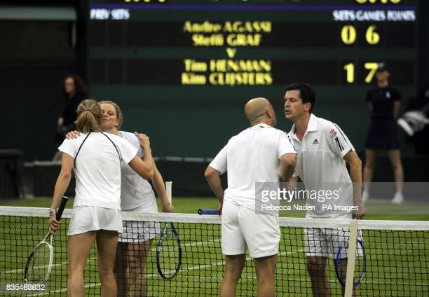 Great Britain's Tim Henman pretends to kiss opponent Andre Agassi at the end of an exhibition match on centre court during the Centre Court...