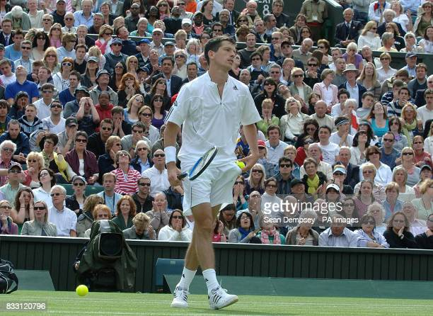 Great Britain's Tim Henman shows his dejection on his way to losing against Spain's Feliciano Lopez during The All England Lawn Tennis Championship...