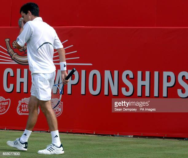 Great britain's Tim Henman walks off after losing to Croatia's Marin Cilic during the Artois Championships at The Queen's Club London