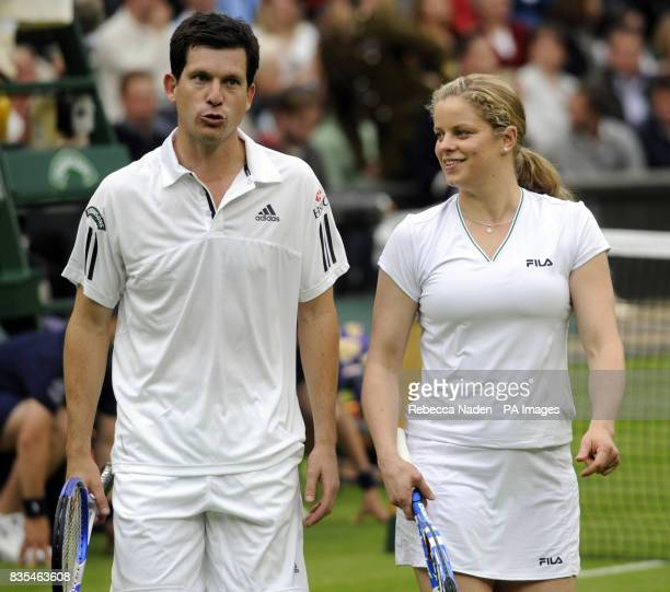 Great Britain's Tim Henman with his partner Kim Clijsters during an exhibition match on centre court against Andre Agassi and wife Steffi Graf during...
