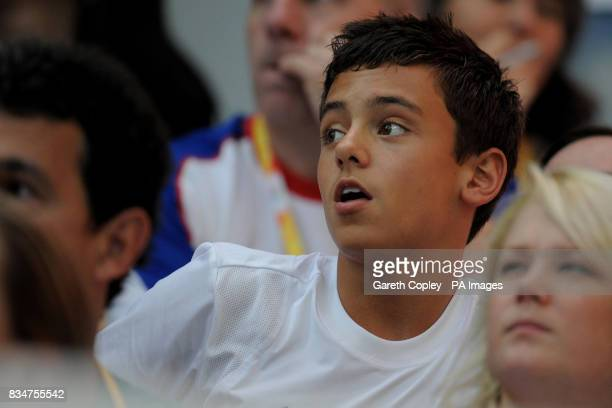 Great Britain's Tom Daley watches team mates Benjamin Swain and Nicholas RobinsonBaker competing in the Men's synchronised 3 metre springboard in the...