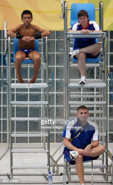 Great Britain's Tom Daley watches team mates practicing at the National Aquatic Centre in Beijing China
