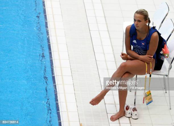 Great Britain's Tonia Couch watches her team mates practice at the National Aquatic Centre in Beijing China